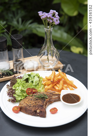 pork chop steak with vegetable salad and potato 43936582