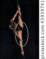 A young flexible girl performs the splits in the aerial ring. Aqua Studio shooting performances on a 43939741