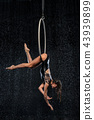 A young girl performs the acrobatic elements in the aerial ring. Aqua Studio shooting performances 43939899