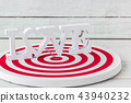 Love Alphabet on Red dartboard over white wood bac 43940232