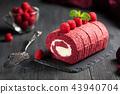 Red velvet Sponge Swiss roll with fresh raspberry 43940704
