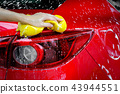 Wash a car with copy space, can use for design. 43944551