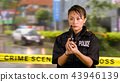 Asian American Police Officer at Crime scene  43946139