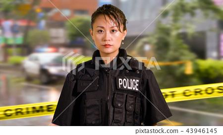 Asian American Police Officer at Crime scene  43946145