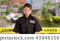 Asian American Police Officer at Crime scene  43946156