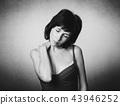 Woman has a neck or shoulder pain 43946252