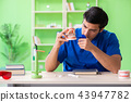 Dentist doctor working on new tooth implant 43947782