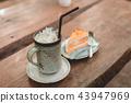 ice coffee and orange cake 43947969