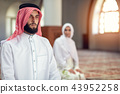 Muslim Praying man and woman in mosque 43952258