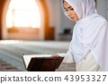 Crop Muslim woman with string of beads 43953327
