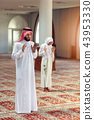 Muslim Praying man and woman in mosque 43953330