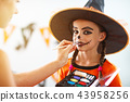 happy family  getting ready for halloween make make-up 43958256