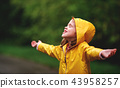 happy child girl enjoying autumn rain 43958257