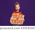 happy Halloween! cheerful child boy in costume with pumpkins on 43958260