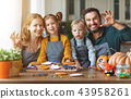 happy Halloween! family mother, father and children getting read 43958261