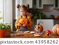 happy child girl in costumes of pumpkins are preparing for  holi 43958262