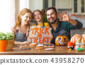 happy Halloween! family mother, father and daughter getting read 43958270