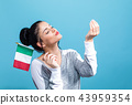 Young woman with a Italian flag 43959354