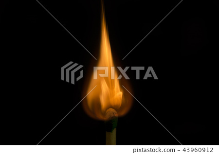 Teardrop shaped flame on tip of match being lit 43960912