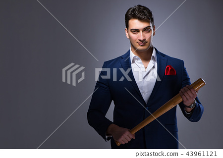 Handsome man against gray background 43961121
