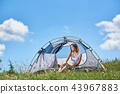 Woman tourist in the camping in the morning 43967883