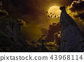 Full moon, silhouette of rock, flock of crows  43968114