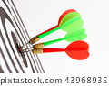 Short green and red darts arrows in the target 43968935