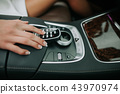 Woman hand pressing on button in vehicle 43970974