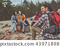 Smile man sitting with his friends outdoor 43971898