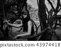 scary woman with bunny mask in wood 43974418