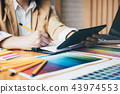 Creative graphic designer using graphics tablet to choosing colo 43974553