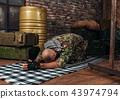 Soldier in uniform praying before terrorist attack 43974794