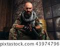 Bearded terrorist in uniform 43974796