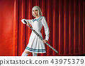 Anime style girl with sword against red container 43975379