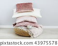 Pink and white pillows on the wall background.  43975578