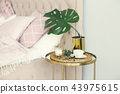 Bedroom with table side and pillows on the bed 43975615