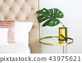 Bedroom with table side and pillows and coffee 43975621