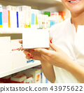 Pharmacist showing medicine box  43975622