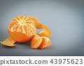 Tangerine with peeled skin 43975623
