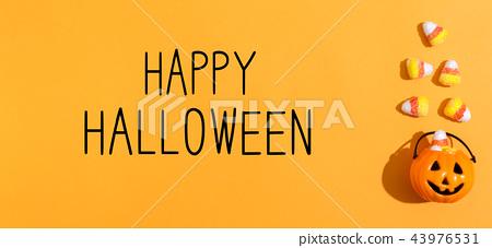 Happy Halloween message with pumpkin overhead view 43976531