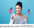 Young woman with American flag 43976561