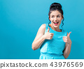 Young woman giving thumbs up 43976569