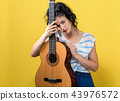 Young woman with a guitar 43976572