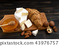 slices of cheese brie or camembert with croissants 43976757