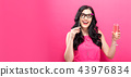 Woman with champagne and party stick 43976834