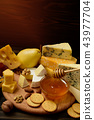 slices of cheese brie or camembert with croissants 43977704