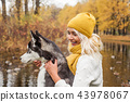 Smiling woman and dog husky together outdoor 43978067