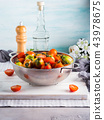 Italian tomatoes in a colander on table 43978675