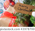 Merry Christmas greeting card with gift 43978700