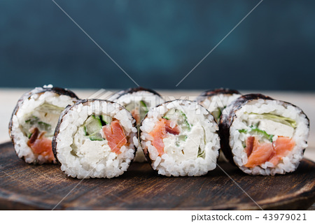 Sushi rolls with pink salmon, free space for text 43979021